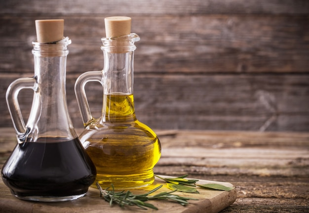 Olive oil and balsamic vinegar on a wooden background Premium Photo
