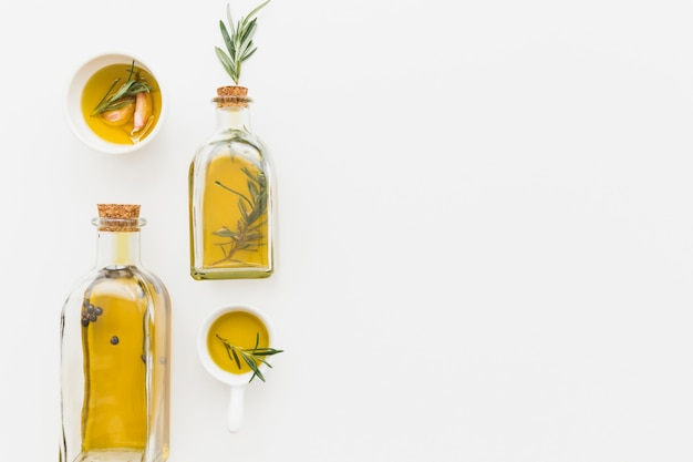 Olive oil in bottles and sauceboats Free Photo