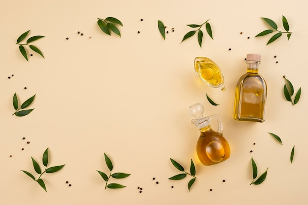 Olive oil frame and leaves with copy space Free Photo