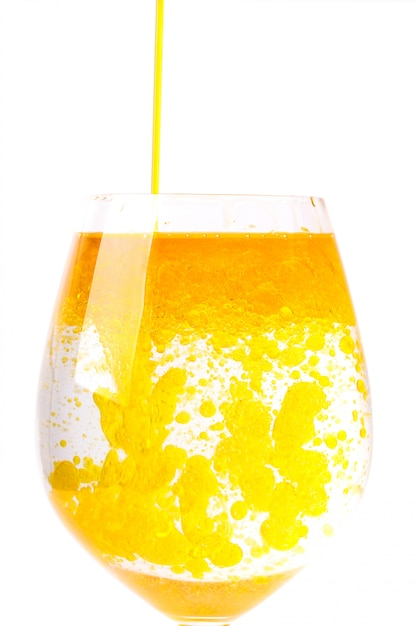 Olive oil in glass of water Free Photo