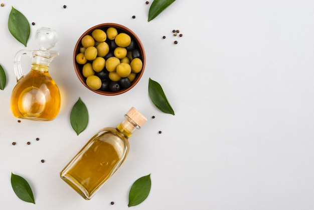 Olive oil and olives with copy space Free Photo