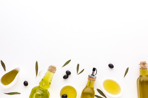 Olive oil saucers and bottles with copy space Free Photo