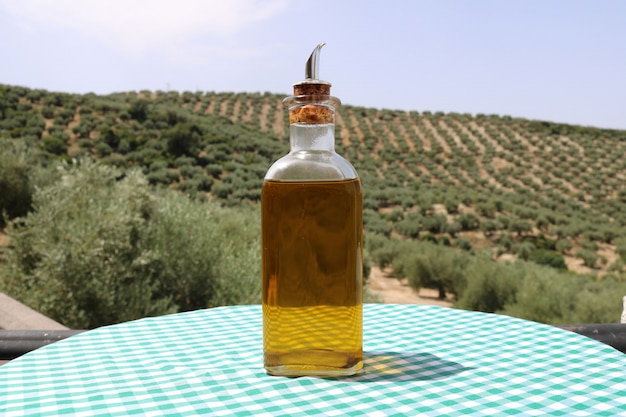 Olive oil with olives background Free Photo