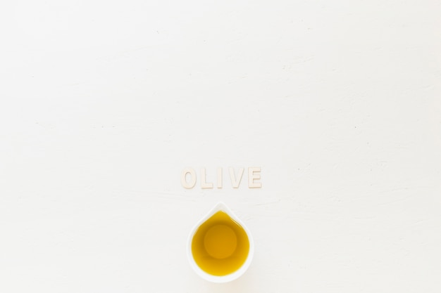 Olive word with olive in sauceboat Free Photo