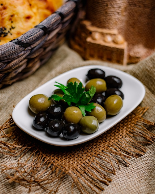 Olives green and black decorated with parsley Free Photo