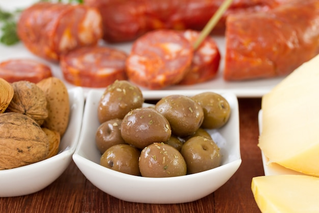 Olives with sausages and cheese Premium Photo