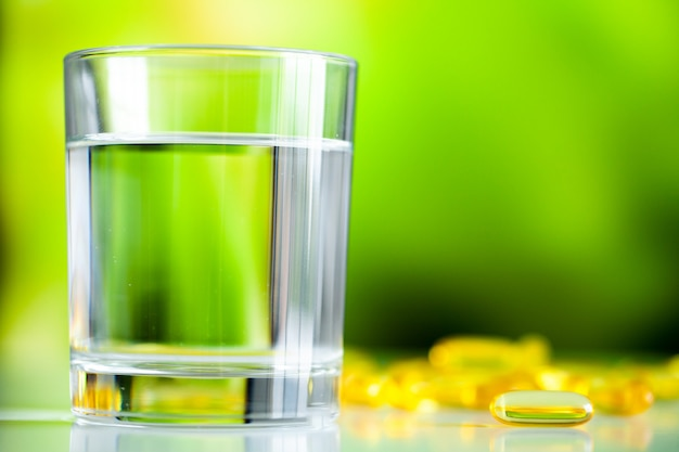 Omega 3 fish oil yellow soft gel capsules. Premium Photo