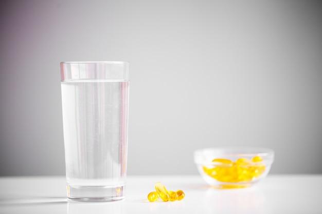 Omega 3 fish oil yellow soft gel capsules. Premium Photo