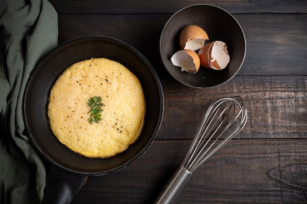 Omelet in a pan onwood. Free Photo