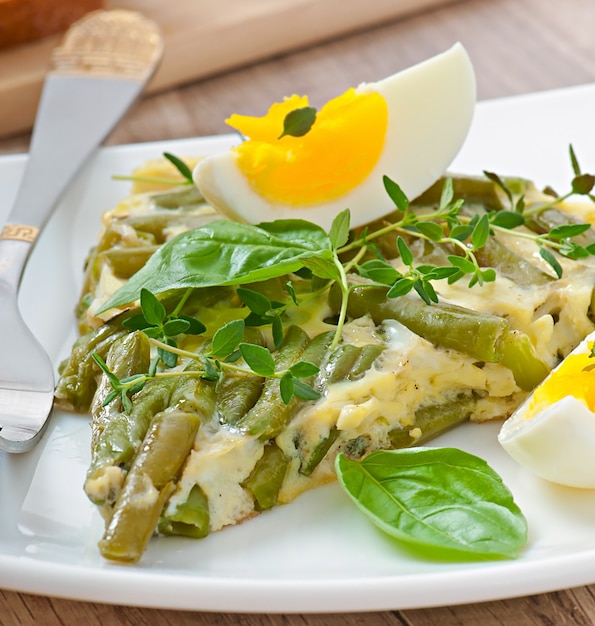 Omelet with green bean Free Photo