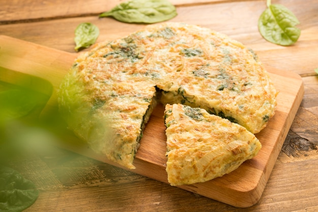 Omelette  of spinach and cheese and leek (3d effect) Premium Photo