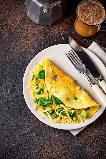 Omelette with green vegetable and cheese Premium Photo