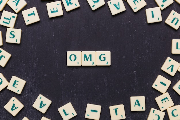 Omg text made from scrabble game letters Free Photo