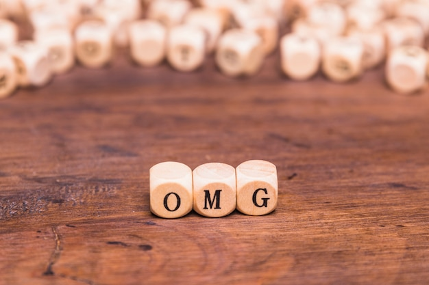 Omg written on a wooden cubes Free Photo