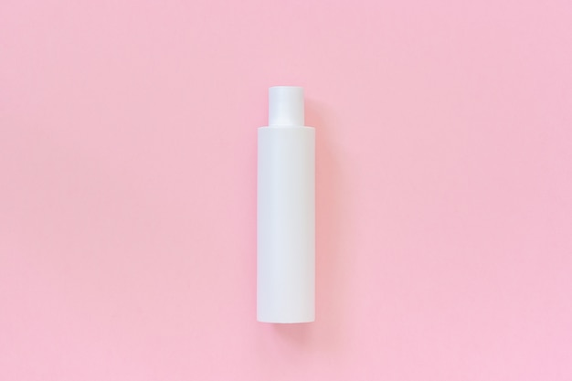 One blank white plastic cosmetic bottle for shampoo, lotion, cream other cosmetic product Premium Photo