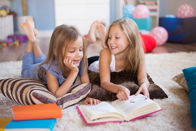 One book and two girls Free Photo