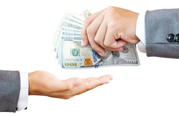 One businessman holding usd banknote for payment and one hand take. us dollar is main and popular currency of exchange in the world. investment and saving concept. Premium Photo