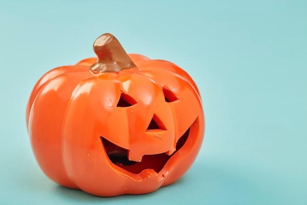 One halloween pumpkin on pastel blue background Premium Photo