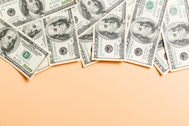 One hundred dollar bills top view of business  on background with copyspace Premium Photo