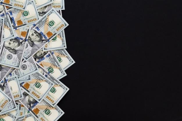 One hundred dollars, new 100 us dollar, black background. Premium Photo