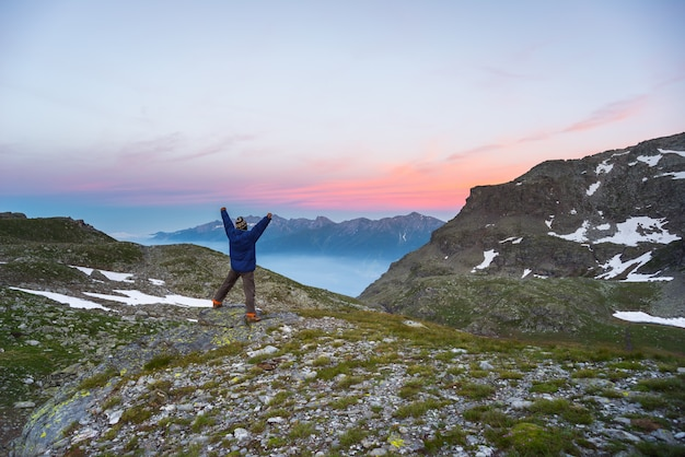 One person watching sunrise high up in the alps Premium Photo