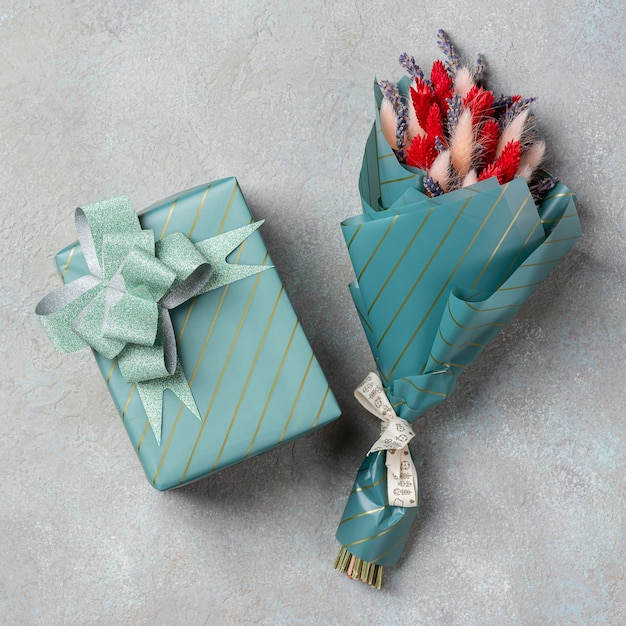 One small bouquet of lavender with lagurus and a gift in turquoise packaging Premium Photo