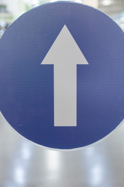One-way traffic arrow sign outdoors Free Photo