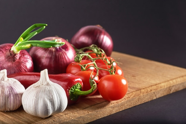Onion and garlic and hot peppers and tomatoes. Free Photo