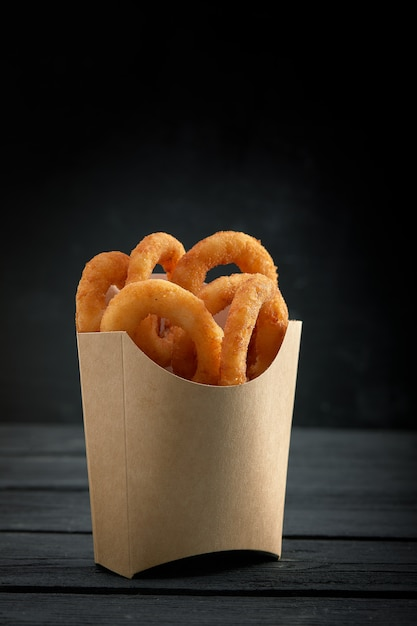 Premium Photo | Onion rings in paper box from a fast food ...