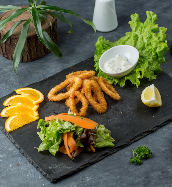 Onion rings on wooden board Free Photo