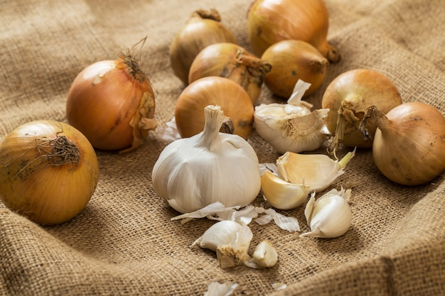 Onions and garlic on blanket Free Photo