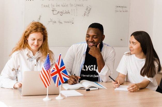 Online multiethnic attractive group of teachers study and laught, discuss something Premium Photo