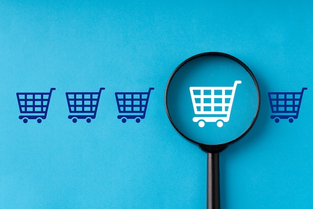 Online shopping & business on retro computer keyboard with magnifying glass Premium Photo
