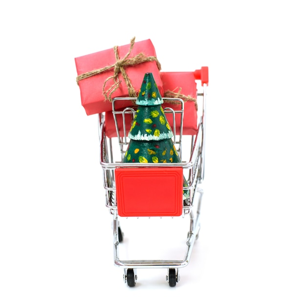 Online shopping concept - trolley full of gifts. black friday and cyber monday Premium Photo