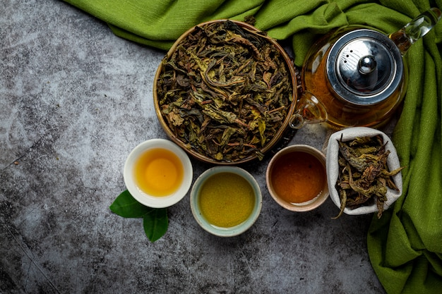 Oolong green tea in a teapot and bowl. Free Photo
