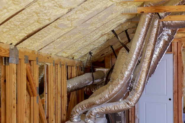 Open ac heating vent and tubing in ceiling of new home construction. Premium Photo