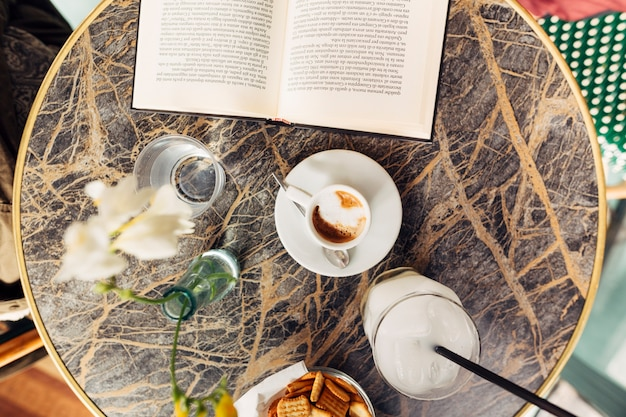 Open book on breakfast time Free Photo