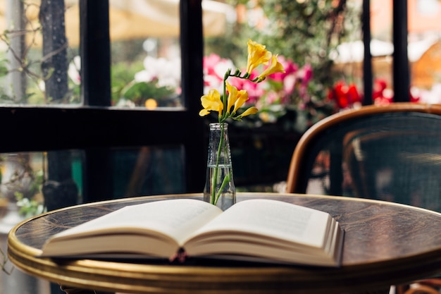 Open book on a table Free Photo
