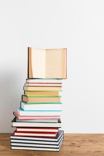 Open book on vivid pile Free Photo