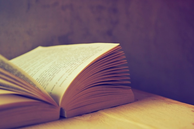 Open book with old filter Free Photo
