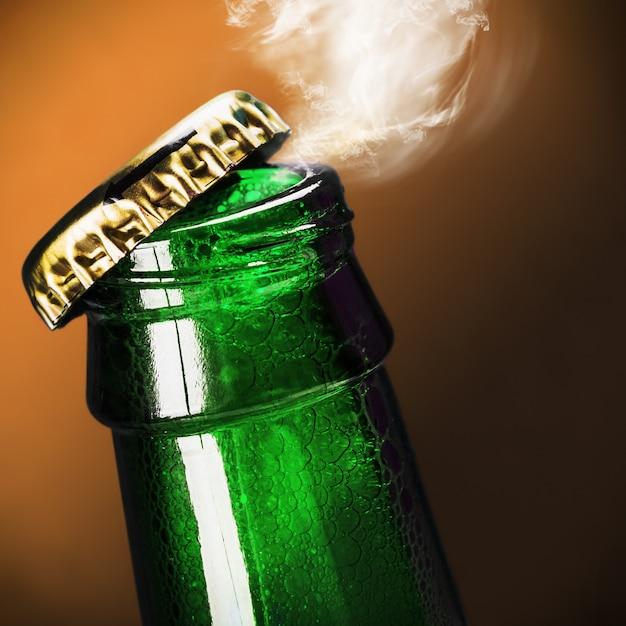 Open bottle of beer Premium Photo