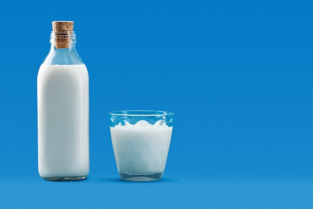 Open bottle and a glass of milk Premium Photo