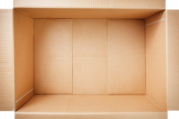 Open cardboard box isolated on white . top view. Premium Photo