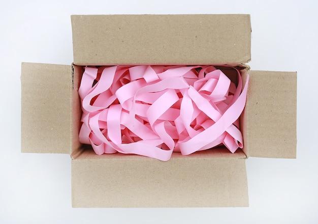 Open carton corrugated cardboard box with prevent bumping paper on white background Premium Photo