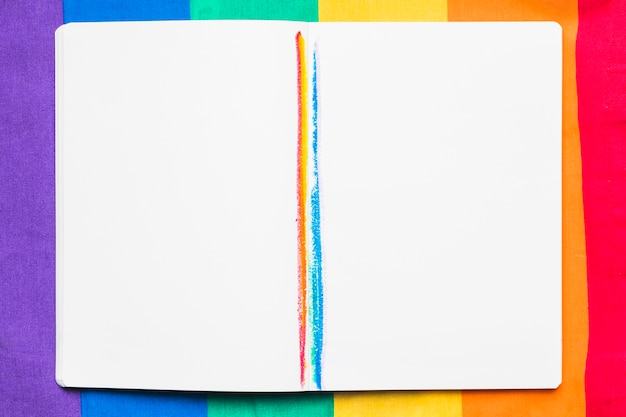 Open copybook with rainbow stripes Free Photo