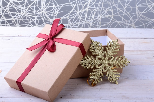 Open gift boxes with bow on wood . christmas decoration Premium Photo