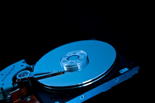 Open hard disk on a black background Free Photo