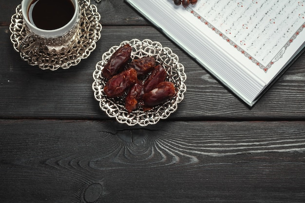 The open holy quran with tasbih/rosary beads close up Premium Photo
