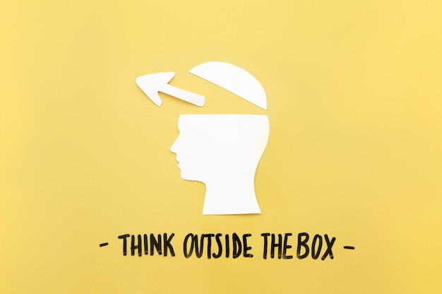 Open human brain with arrow symbol near think outside the box message Free Photo