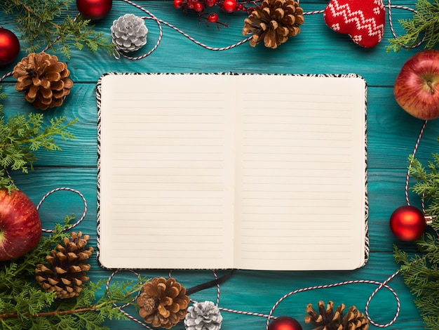 Open notebook on christmas Premium Photo